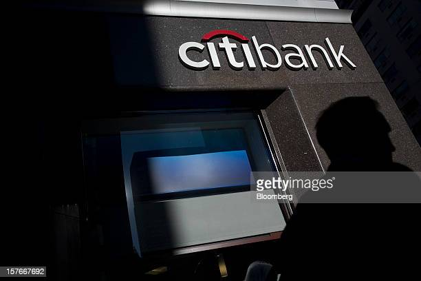 A pedestrian walks past a Citibank branch located adjacent to Citigroup Inc headquarters in New York US on Thursday Sept 20 2012 Citigroup Inc Chief...