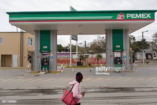 A pedestrian walks past a closed Petroleos Mexicanos gas station after looting in Veracruz City Mexico on Saturday Jan 7 2017 Mexico's National...