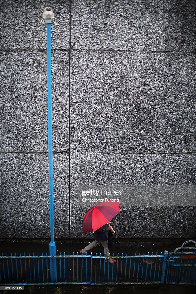 A pedestrian walks past a concrete wall on the Falinge Estate, which has been surveyed as the most deprived area in England for a fifth year in a row, on January 8, 2013 in Rochdale, England. According to data provided by the Department for Communities and Local Government, 72 per cent of people in the local area are unemployed and seven per cent have never had a job. Four out of five children on the estate are living in poverty, with the area having one of the highest teenage pregnancy rates in the country. During today's House of Commons debate, the government urged MPs to back their planned 1 per cent cap on annual rises in benefits and some tax credits for three years from next April. Benefits for people of working age have historically risen in line with the rate of inflation.