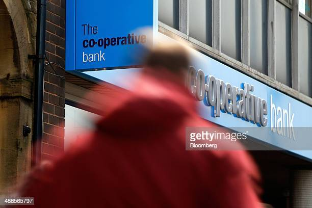 A pedestrian walks past a CoOperative Bank Plc branch in Huddersfield UK on Wednesday May 7 2014 Former CoOperative Bank Chairman Paul Flowers was...
