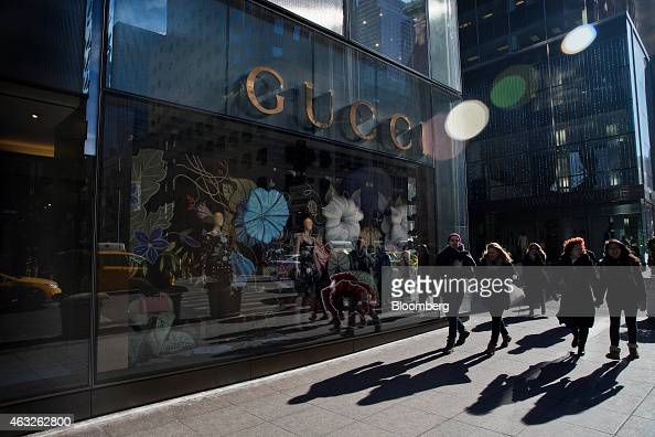 A pedestrian walks past a Gucci store on 5th Avenue in New York US on Wednesday Feb 11 2015 Sales at US retailers fell more than forecast in January...
