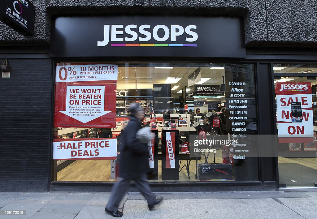 A pedestrian walks past a Jessops camera store offering discounted products in London, U.K., on Wednesday, Jan. 9, 2013. PricewaterhouseCoopers LLC were today appointed administrators of U.K. camera retailer The JessopGroup Ltd. Photographer: Chris Ratcliffe/Bloomberg via Getty Images