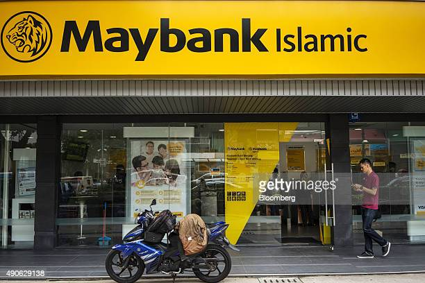 A pedestrian walks past a Maybank Islamic Bhd bank branch in the Bukit Bintang area of Kuala Lumpur Malaysia on Tuesday Sept 29 2015 The ringgit's...