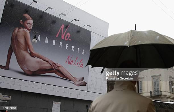 Pedestrian walks past a Nolita advertising poster during Spring/Summer 2008 fashion week on September 26 2007 in Milan Isabelle Caro had her naked...