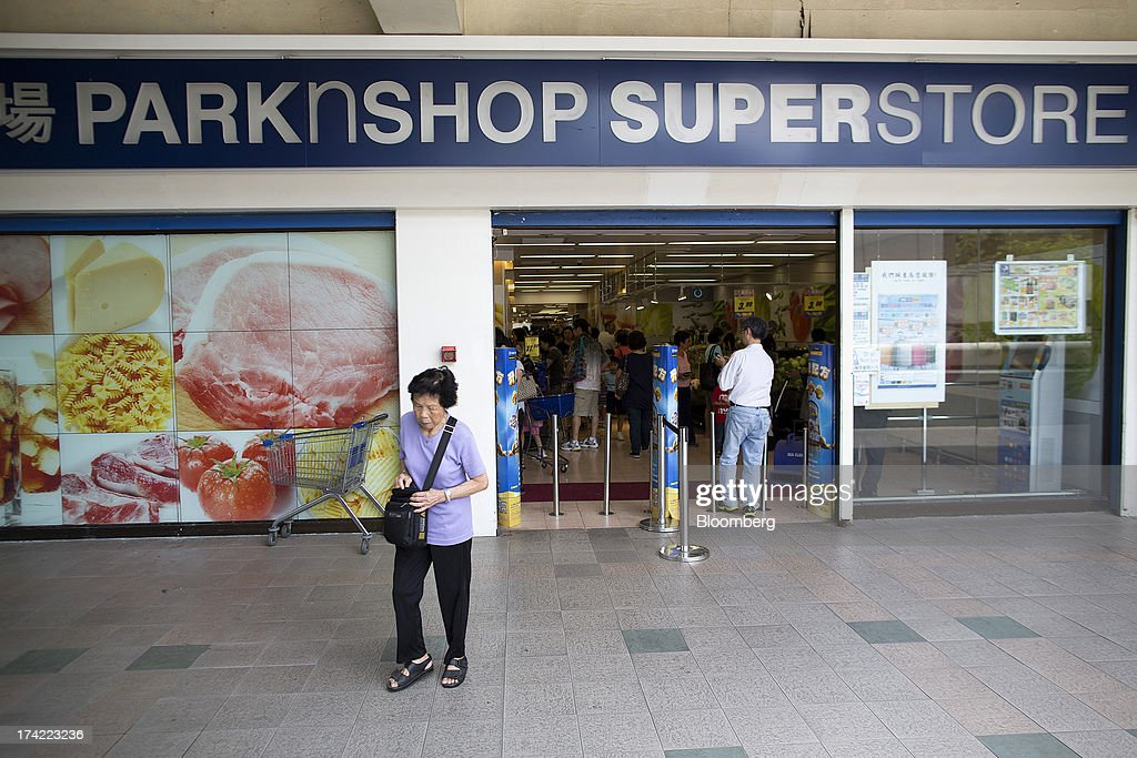 A pedestrian walks past a ParknShop superstore supermarket, operated by Hutchison Whampoa Ltd., in Hong Kong, China, on Monday, July 22, 2013. Billionaire Li Ka-shing's biggest company may exit one of the two largest supermarket operations in Hong Kong as it seeks to grow other businesses. Photographer: Jerome Favre/Bloomberg via Getty Images