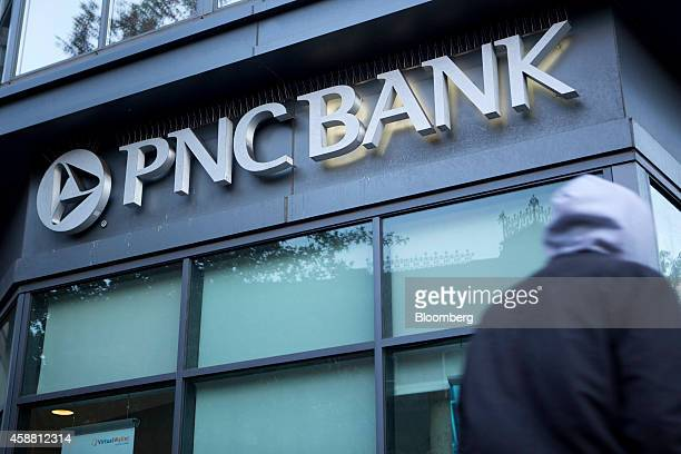 A pedestrian walks past a PNC Bank branch in Washington DC US on Tuesday Nov 11 2014 PNC Financial Services Group Inc the secondbiggest US regional...