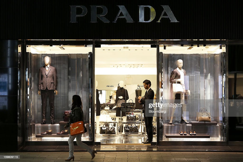 A pedestrian walks past a Prada SpA store in the Ginza district of Tokyo, Japan, on Sunday, Jan. 20, 2013. Japan's consumer prices excluding fresh food, a benchmark monitored by the central bank, haven't advanced 2 percent for any year since 1997, when a national sales tax was increased. Photographer: Kiyoshi Ota/Bloomberg via Getty Images