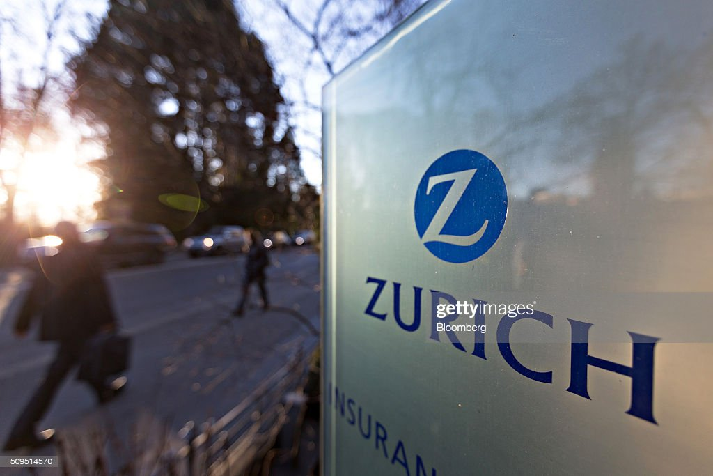 A pedestrian walks past a sign outside the Zurich Insurance Group AG's headquarters ahead of the company's full year results news conference in Zurich, Switzerland, on Thursday, Feb. 11, 2016. Zurich Insurance reported a worse-than-expected loss in the fourth quarter as the company makes plans to turn around its unprofitable general insurance unit. Photographer: Michele Limina/Bloomberg via Getty Images
