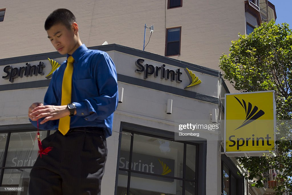 A pedestrian walks past a Sprint Nextel Corp. store in San Francisco, California, U.S., on Thursday, June 13, 2013. SoftBank Corp. Chief Executive Officer Masayoshi Son, seeking to expand into the U.S. wireless market, said he sees T-Mobile US Inc. as a 'Plan B' acquisition target if he fails to purchase Sprint Nextel Corp. Photographer: David Paul Morris/Bloomberg via Getty Images