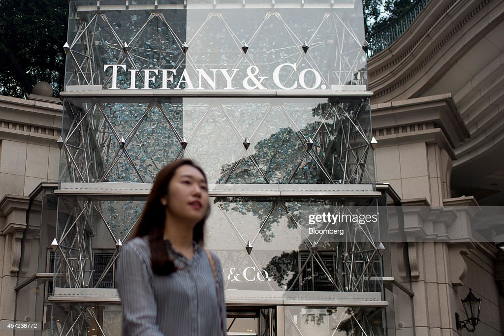 A pedestrian walks past a Tiffany Co store on Canton Road in the Tsim Sha Tsui area of Hong Kong China on Wednesday Oct 15 2014 Hong Kong police said...