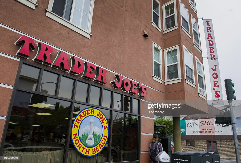 A pedestrian walks past a Trader Joe's Co. store in San Francisco, California, U.S., on Friday, Sept. 13, 2013. Trader Joe's Co., the closely held grocery store chain, will end health benefits for part-time workers next year, directing them instead to anew insurance marketplaces as companies revamp medical coverage to fit the U.S. Affordable Care Act. Photographer: David Paul Morris/Bloomberg via Getty Images