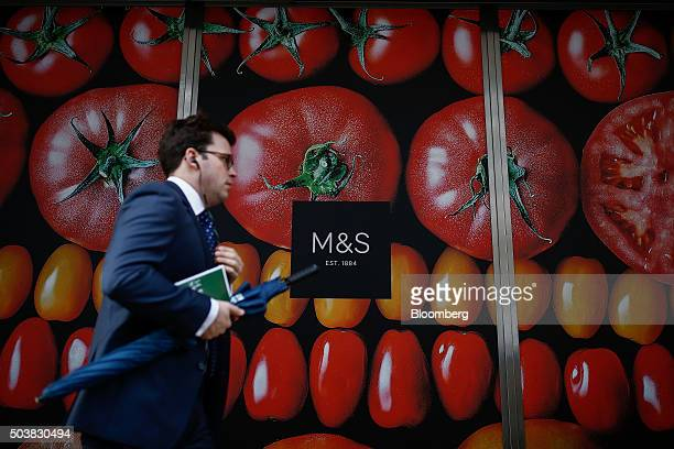 A pedestrian walks past an advertisement for food outside a Marks And Spencer Plc store on Oxford Street in London UK on Thursday Jan 7 2016 Marks...