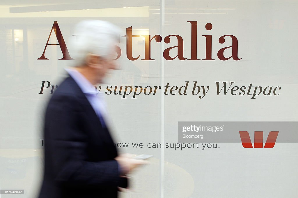 A pedestrian walks past an advertisement for Westpac Banking Corp. in Sydney, Australia, on Friday, May 3, 2013. Westpac, Australia's second-biggest lender by market value, will pay a special dividend for the first time since 1988 after first-half cash earnings rose 10 percent on tighter cost controls. Photographer: Brendon Thorne/Bloomberg via Getty Images