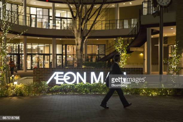 A pedestrian walks past an Aeon shopping mall operated by Aeon Mall Co a unit of Aeon Co in Tokyo Japan on Monday April 10 2017 Aeon Co Japan's...