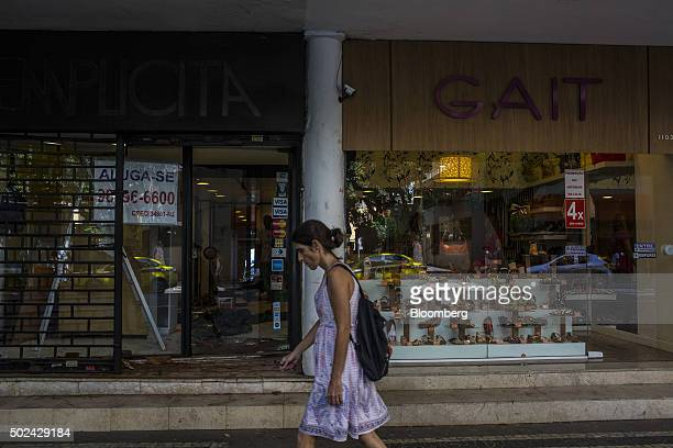 A pedestrian walks past an empty business space in Rio de Janeiro on Thursday Dec 24 2015 Brazil has slipped deeper into recession with gross...