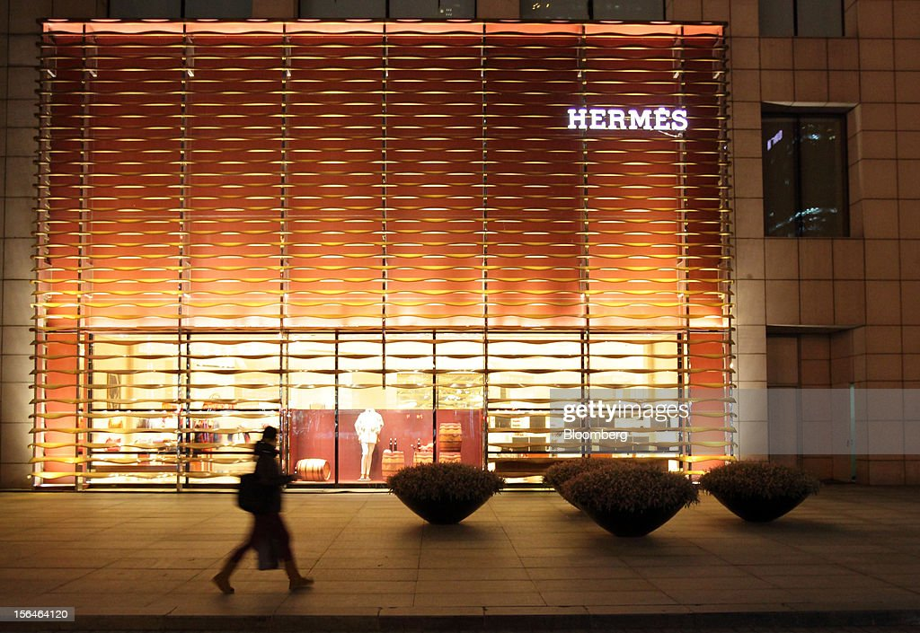 A pedestrian walks past an Hermes store, operated by Hermes International SCA, in Beijing, China, on Monday, Nov. 12, 2012. China's retail sales exceeded forecasts and inflation unexpectedly cooled to the slowest pace in 33 months, signaling the government is boosting growth without driving a rebound in prices. Photographer: Tomohiro Ohsumi/Bloomberg via Getty Images