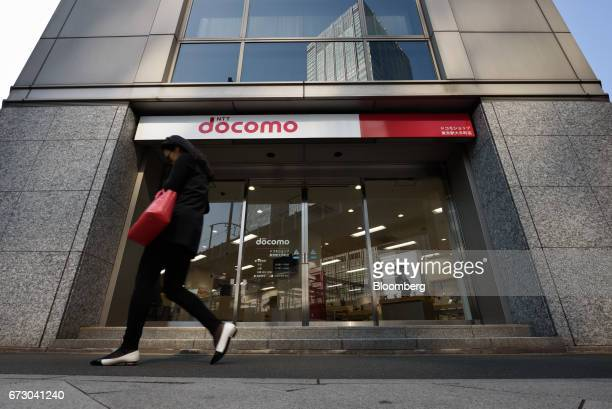 A pedestrian walks past an NTT Docomo Inc store in Tokyo Japan on Monday April 24 2017 NTT Docomo one of the world's largest wireless network...