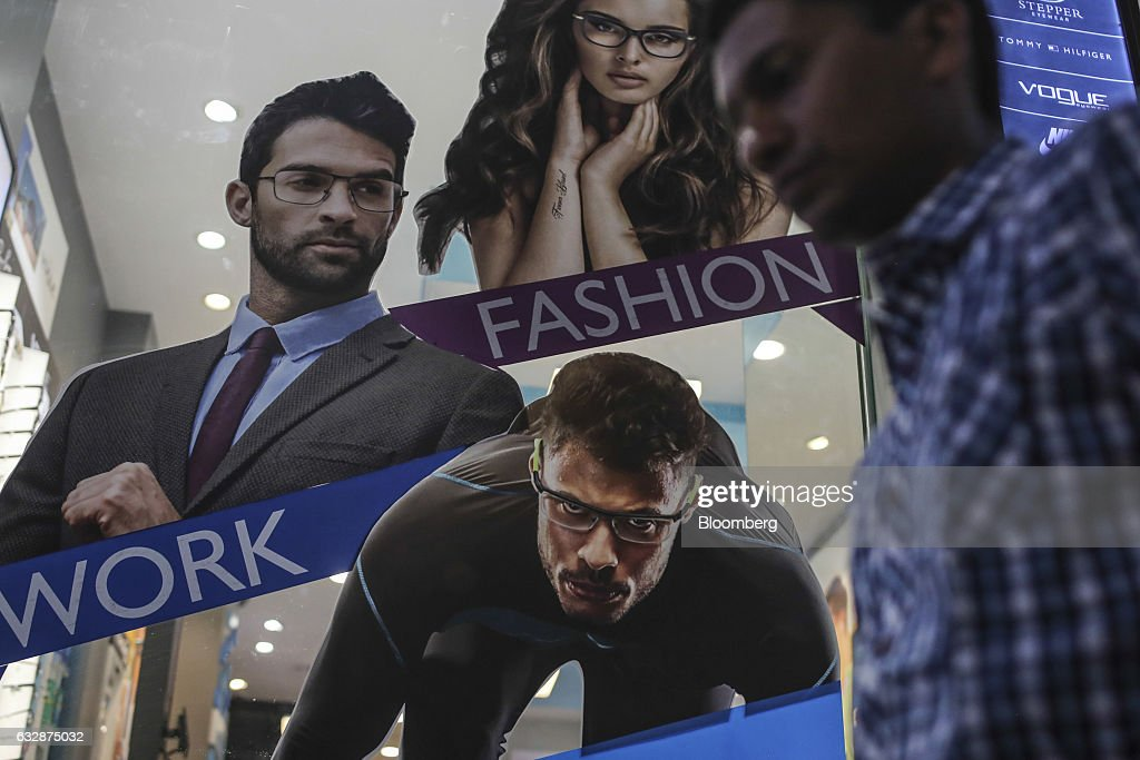 eyeglasses direct 1jdz  A pedestrian walks past by an advertisement for eyeglasses frames in  Mumbai, India, on