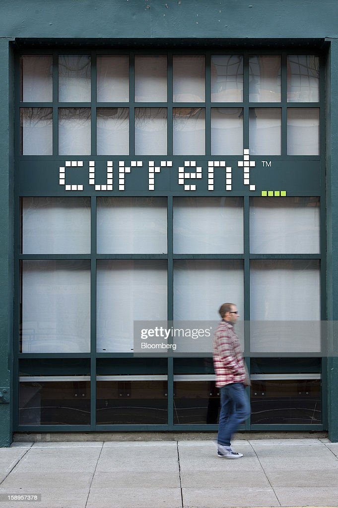 A pedestrian walks past Current TV LLC headquarters in San Francisco, California, U.S., on Friday, Jan. 4, 2013. Al Jazeera will pay about $500 million for Current TV, including the stake held by former vice president Al Gore according to two people with knowledge of the deal. Photographer: David Paul Morris/Bloomberg via Getty Images