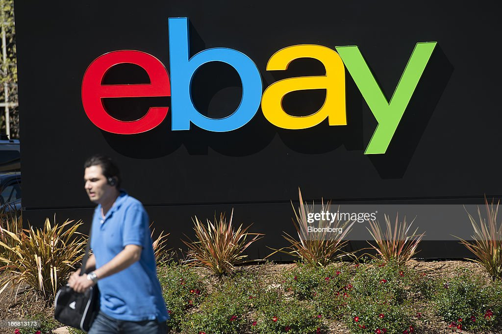A pedestrian walks past eBay Inc. signage outside of the company's headquarters in San Jose, California, U.S., on Tuesday, April 16, 2013. Ebay Inc. is expected to release earnings data on April 17. Photographer: David Paul Morris/Bloomberg via Getty Images