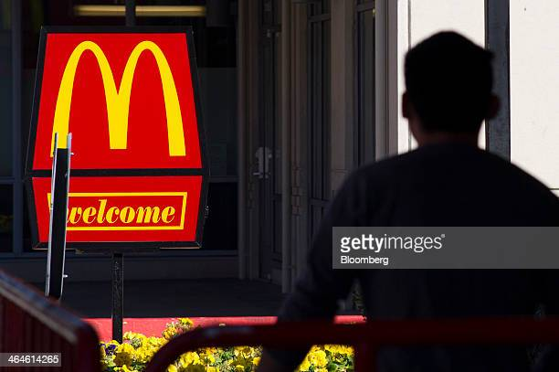 A pedestrian walks past McDonald's Corp signage in front of a restaurant in San Pablo California US on Wednesday Jan 22 2014 McDonald's Corp the...