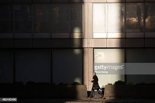 A pedestrian walks past New Scotland Yard the headquarters of London's Metropolitan Police Service in London UK on Monday Dec 15 2014 New Scotland...