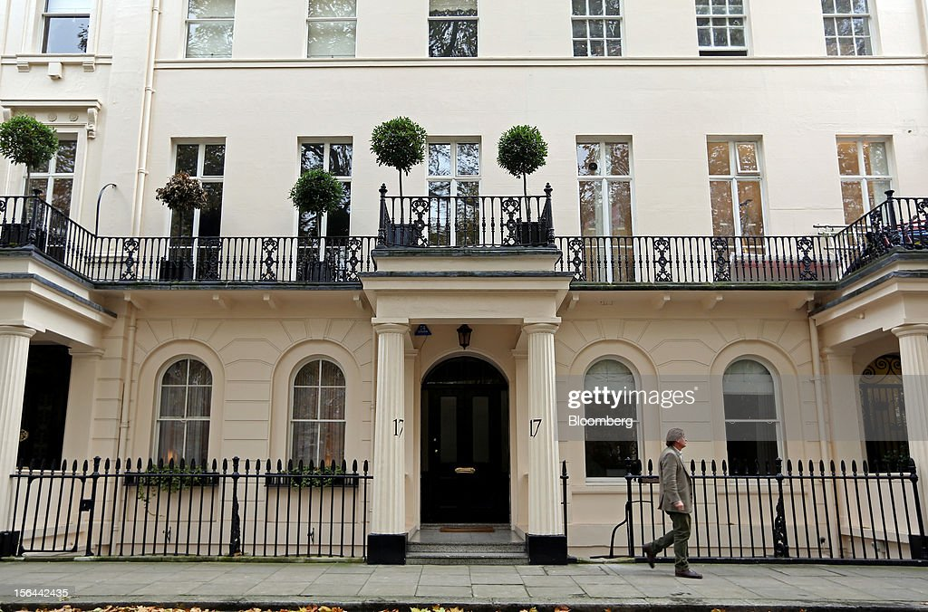 A pedestrian walks past residential property in Eaton Place in the London area of Belgravia, in London, U.K., on Thursday, Nov. 15, 2012. London luxury homes won't rise in value next year for the first time since 2008 as proposals to extend property transaction taxes deter buyers, Jones Lang LaSalle Inc. said. Photographer: Chris Ratcliffe/Bloomberg via Getty Images