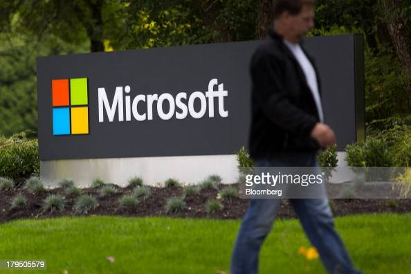 A pedestrian walks past signage displayed at the Microsoft Corp campus in Redmond Washington US on Wednesday Sept 4 2013 Microsoft Corp agreed to buy...