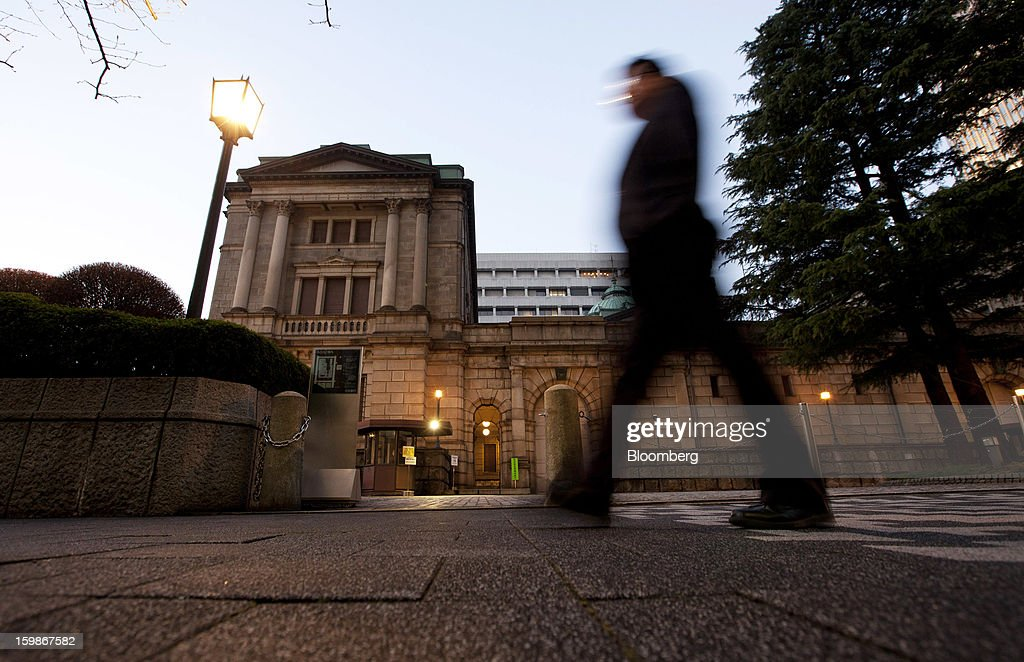 A pedestrian walks past the Bank of Japan headquarters in Tokyo, Japan, on Tuesday, Jan. 22, 2013. The Bank of Japan set a 2 percent inflation target and said it will shift to Federal Reserve-style open-ended asset purchases in its strongest commitment yet to ending two decades of deflation. Photographer: Tomohiro Ohsumi/Bloomberg via Getty Images