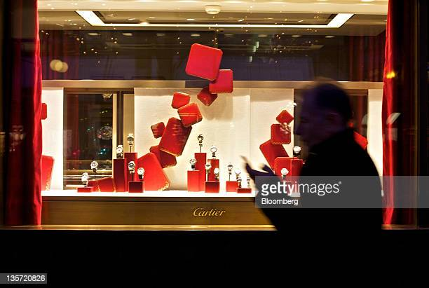 A pedestrian walks past the Cartier store Christmas window display in Zurich Switzerland on Monday Dec 12 2011 Switzerland's economy is cooling as...