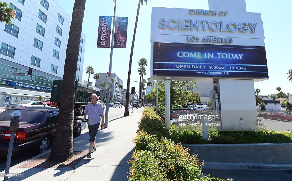 A pedestrian walks past the Church of Scientology along Sunset Boulevard in Hollywood California on July 9 2012 US actor Tom Cruise and Katie Holmes...