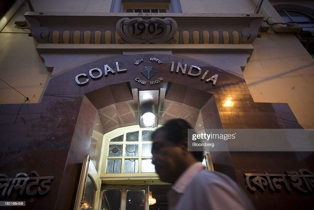 A pedestrian walks past the Coal India Ltd. headquarters in Kolkata, India, on Tuesday, Feb. 19, 2013. Coal India, the world's biggest producer of the fuel, has been grappling with stalled production growth for the past three years. Photographer: Brent Lewin/Bloomberg via Getty Images