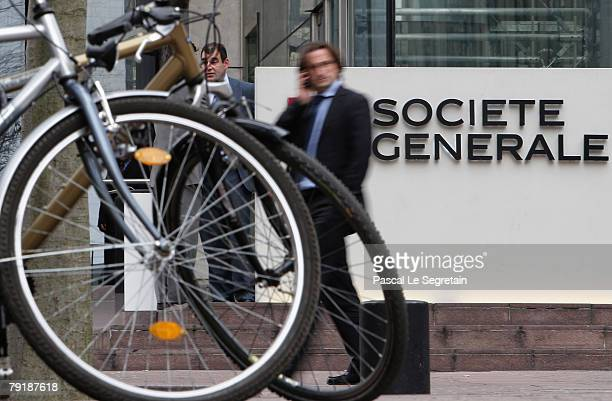 Pedestrian walks past the corporate logo of Societe Generale Bank outside the bank's headquarters on January 24 2008 in La Defense Fraud by a single...