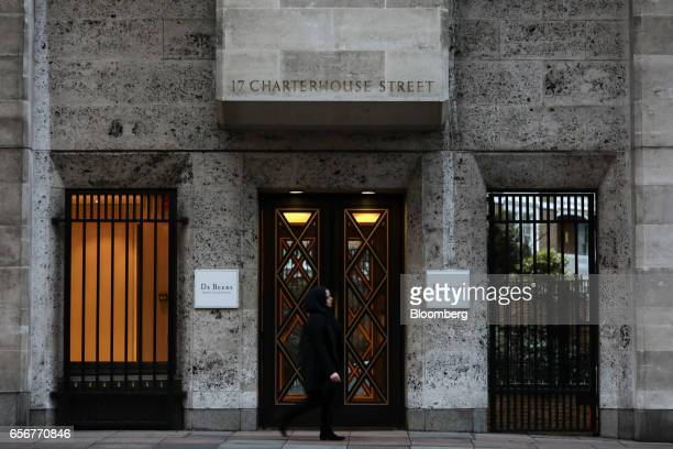 A pedestrian walks past the De Beers SA headquarters on Charterhouse Street in London UK on Wednesday Feb 1 2017 Number 17 Charterhouse Street a...