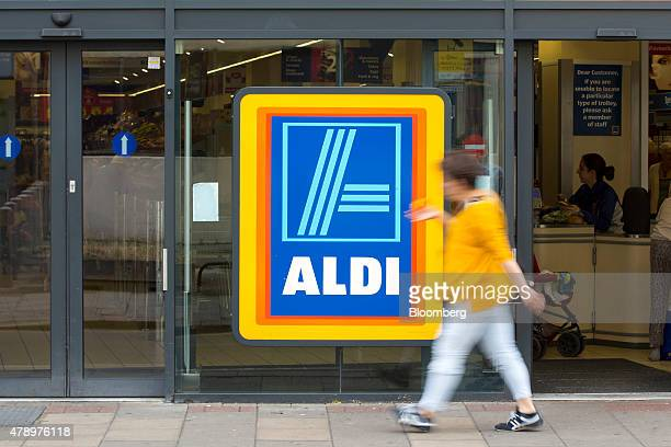 A pedestrian walks past the entrance to an Aldi supermarket store in London UK on Monday June 29 2015 The growth of Aldi and fellow Germanowned...
