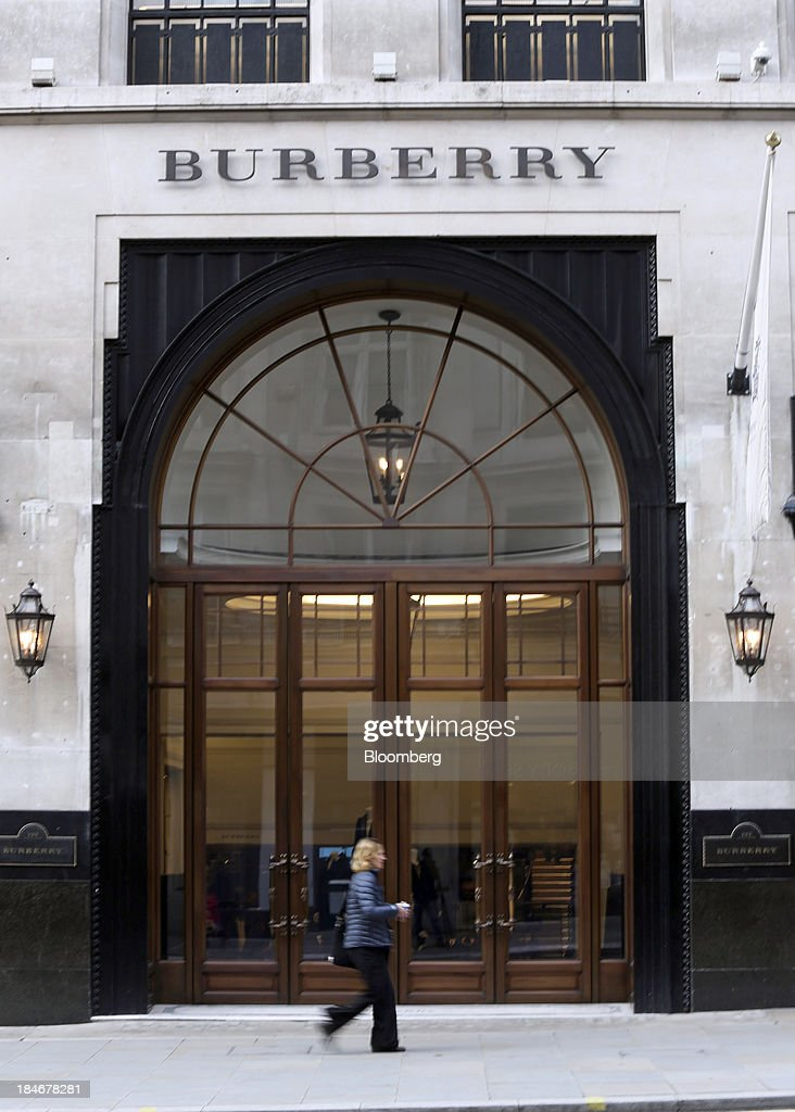 A pedestrian walks past the entrance to Burberry Group Plc's luxury clothing store on Regent Street in London, U.K., on Tuesday, Oct. 15, 2013. Burberry named Christopher Bailey as chief executive officer to succeed Angela Ahrendts who will leave in 2014 to work as a senior vice president at Apple Inc. Photographer: Chris Ratcliffe/Bloomberg via Getty Images