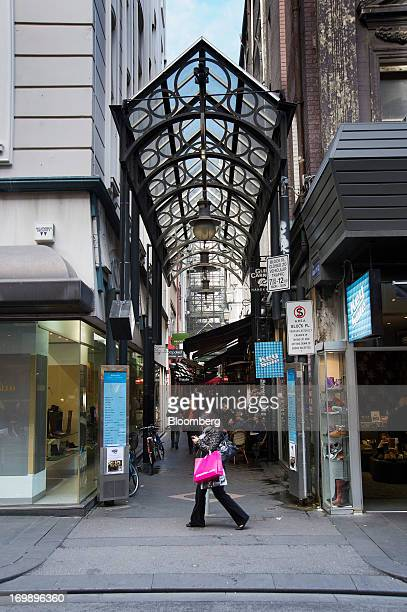 A pedestrian walks past the entrance to The Block Arcade in central Melbourne Australia on Sunday June 2 2013 The Australian Bureau of Statistics is...
