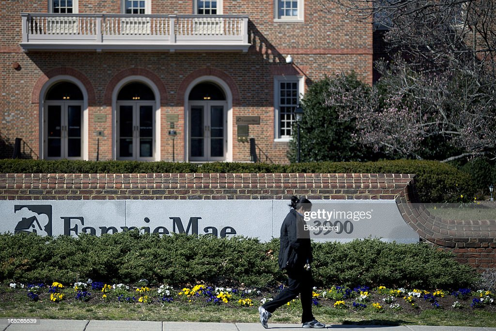 A pedestrian walks past the Fannie Mae headquarters in Washington, D.C., U.S., on Tuesday, April 2, 2013. Fannie Mae, the mortgage financier seized by U.S. regulators during the credit crisis, reported the largest annual profit in company history as a housing rebound helped the firm stop drawing federal aid. Photographer: Andrew Harrer/Bloomberg via Getty Images