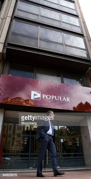 A pedestrian walks past the headquarters of Banco Popular in Madrid Spain on Wednesday Oct 8 2008 Spain's plan to spend up to 50 billion euros buying...