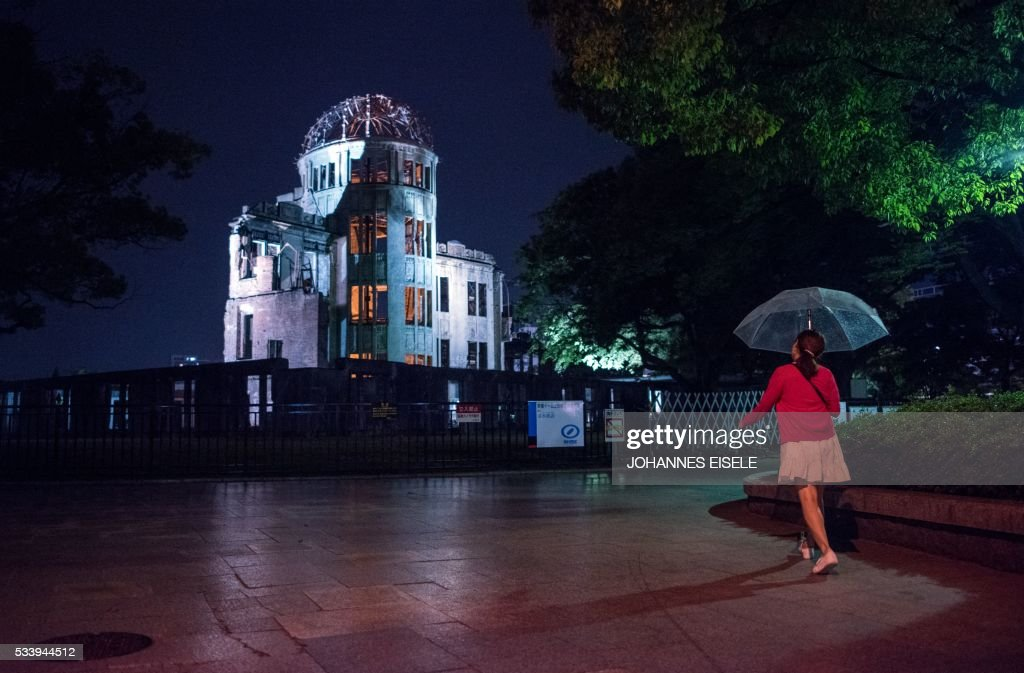 A pedestrian walks past the Hiroshima Peace Memorial Genbaku Dome in Naka Ward, Hiroshima Prefecture on May 24, 2016. US President Barack Obama is scheduled to make a historic visit to the atomic-bombed city on May 27. / AFP / JOHANNES