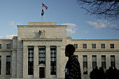 A pedestrian walks past the Marriner S Eccles Federal Reserve building in Washington DC US on Tuesday Dec 15 2015 Economists and traders expect the...