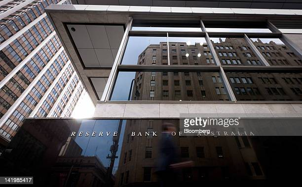 A pedestrian walks past the Reserve Bank of Australia headquarters in Sydney Australia on Wednesday March 28 2012 Australia's financial system will...