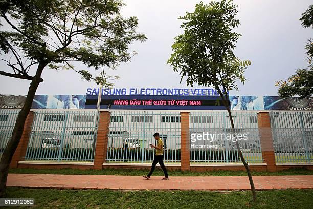 A pedestrian walks past the Samsung Electronics Vietnam Co Plant at Yen Phong Industrial Park in Bac Ninh Province Vietnam on Thursday Sept 1 2016...