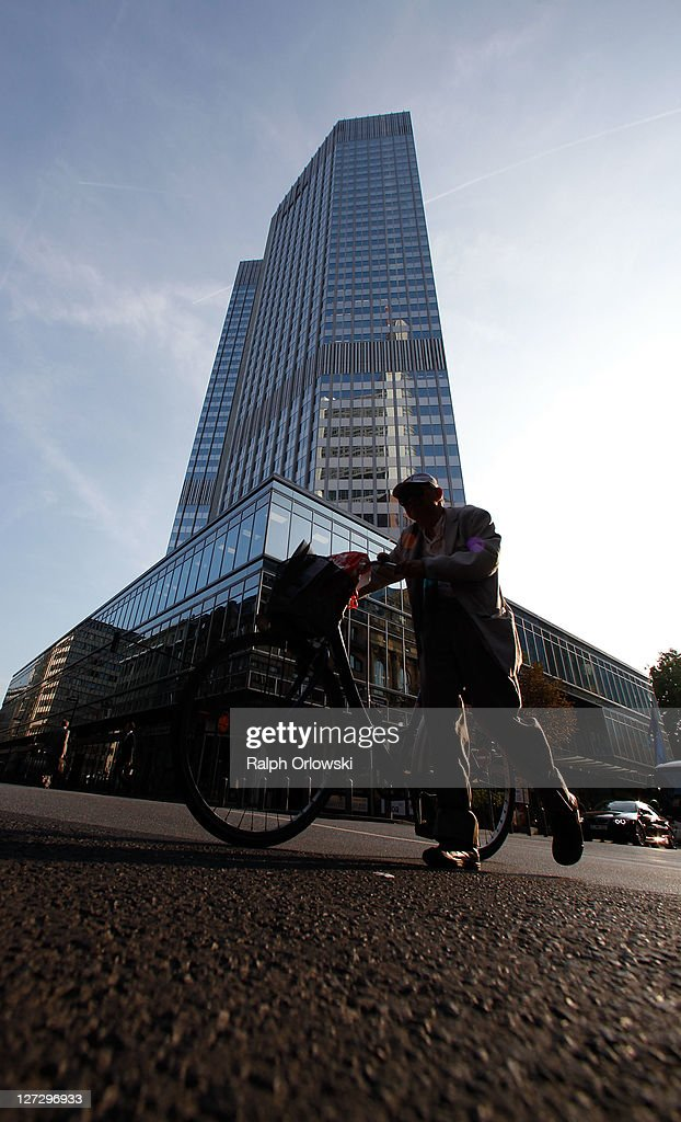 A pedestrian walks past the symbol of the European common currency, the Euro at the headquarters of the European Central Bank (ECB) on September 27, 2011 in Frankfurt am Main, Germany. Europe is continuing to wrestle with the ominous prospect of a Greek debt default that many fear could spread panic and push the already fragile economies of Italy, Portugal and Spain into a crisis that would rock the Eurozone and lead to global repercussions. On Thursday the Bundestag, under the urging of German Chancellor Angela Merkel, is expected to pass an increase in funding for the European Financial Stability Facility (EFSF), a measure many see as necessary for financial markets to regain confidence in the European banking system.