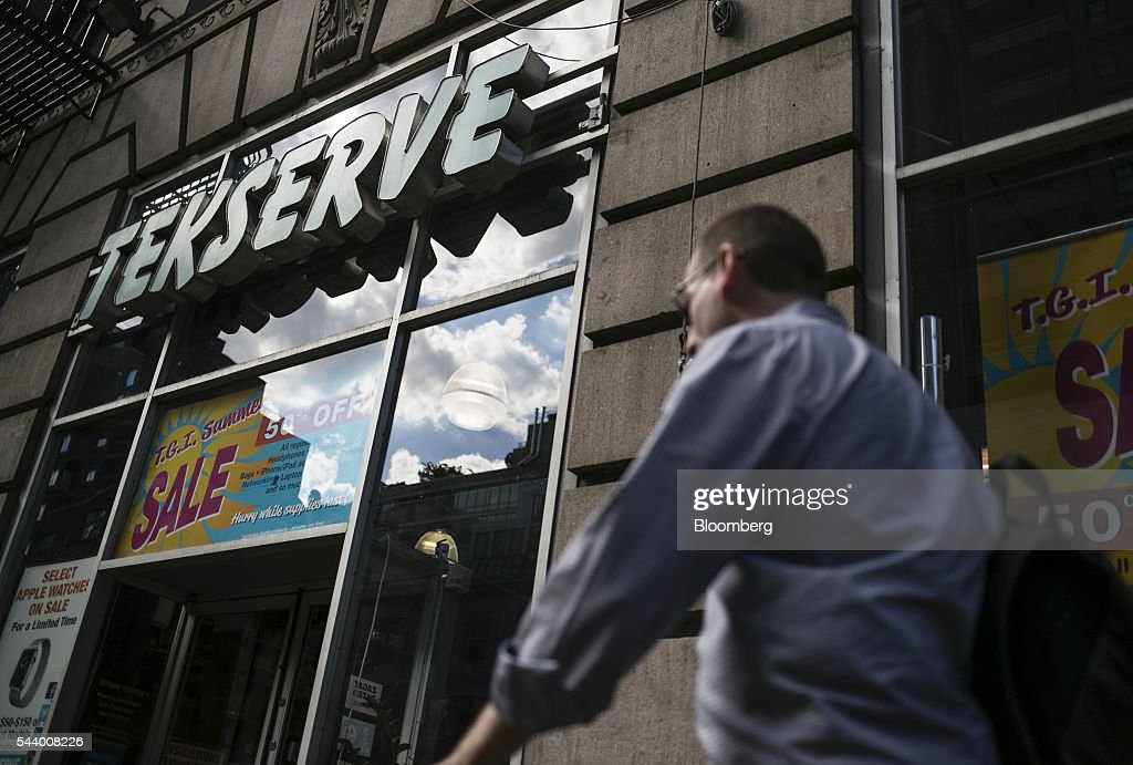 A pedestrian walks past the Tekserve store on 23rd Street in New York, U.S., on Thursday, June 30, 2016. New York City's original Apple repair store, Tekserve, is closing, succumbing to competition and rising rents after almost 30 years of servicing computers and providing technical support to local residents. Photographer: Victor J. Blue/Bloomberg via Getty Images