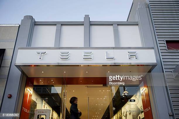 A pedestrian walks past the Tesla Motors Inc store on the Third Street Promenade in Santa Monica California US on Wednesday March 30 2016 Tesla Motor...
