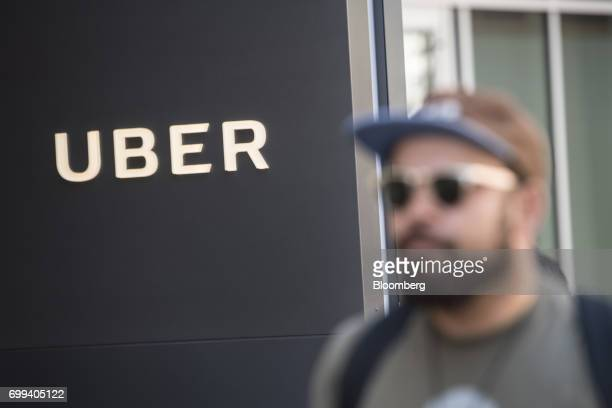 A pedestrian walks past the Uber Technologies Inc headquarters building in San Francisco California US on Wednesday June 21 2017 Travis Kalanick has...
