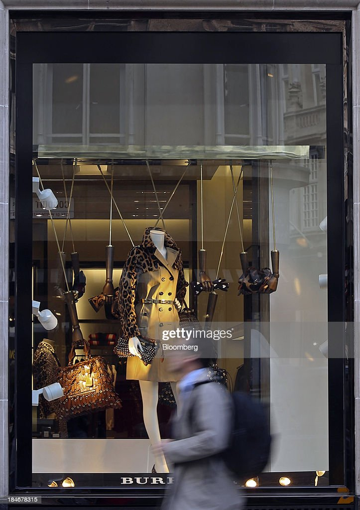 A pedestrian walks past the window display of a Burberry Group Plc luxury clothing store on New Bond Street in London, U.K., on Tuesday, Oct. 15, 2013. Burberry named Christopher Bailey as chief executive officer to succeed Angela Ahrendts who will leave in 2014 to work as a senior vice president at Apple Inc. Photographer: Chris Ratcliffe/Bloomberg via Getty Images