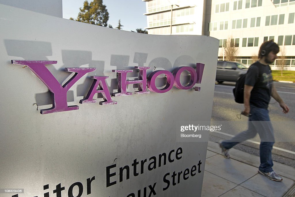 A pedestrian walks past Yahoo Inc signage outside of the company's headquarters in Sunnyvale California US on Tuesday Jan 25 2011 Yahoo the...