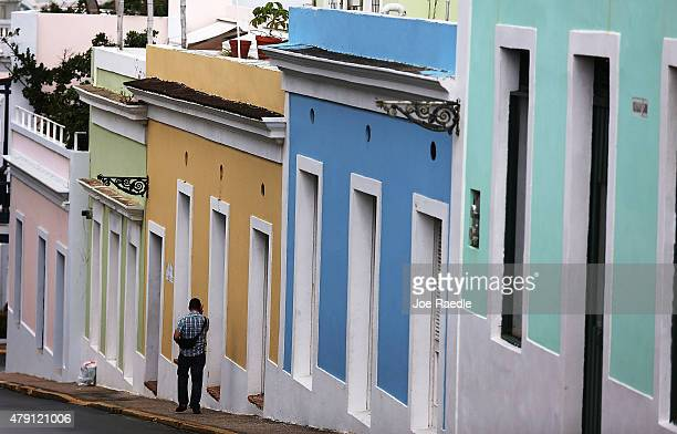 A pedestrian walks through a street in Old San Juan as the island's residents deal with the government's $72 billion debt on July 1 2015 in San Juan...